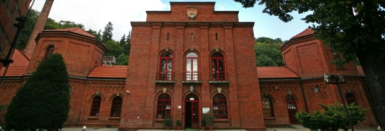 The main building is made of brick, shot from the outside.