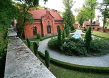A view of a part of the building with a garden.