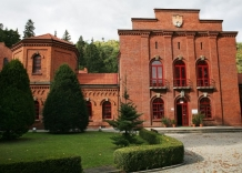 The main building made of brick, side view.