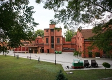 The main building made of brick.
