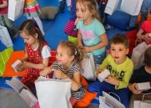 Children watch waterworks gifts.